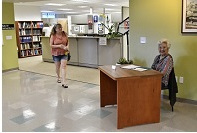 Image of lady sitting at the front office